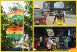Shots on my way to the restaurant.  Ghanaian flags flying high on a sunny day and locals working hard